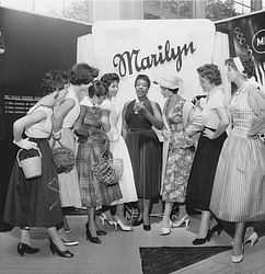 "Models at a fair stall at the ""Internationaler Salon der Schönheit und Mode"" (""International beauty and fashion fair""), in Munich, 1955, photographed by Felicitas Timpe 