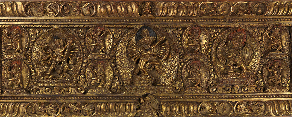 Gilded Tibetan book cover with Tantric representations | © BSB/ Cod.tibet. 923